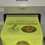Direct to Garment printing on yellow shirt